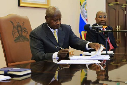 Uganda President Yoweri Museveni signs the Administration of the Judiciary Bill into Law.
